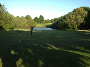Golfer near the water