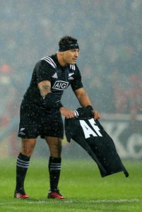 Maori captain presents a Maori shirt with AF (Anthony Foley) on the back of it
